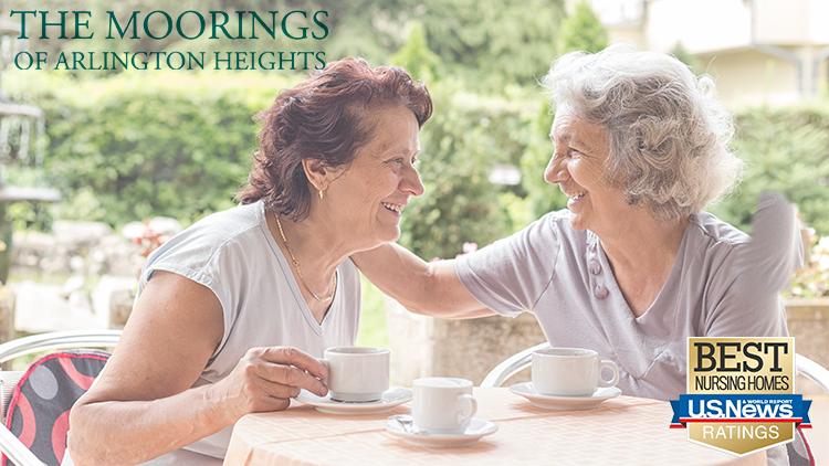 Two The Moorings of Arlington Heights residents enjoy spending time together in the retirement community.