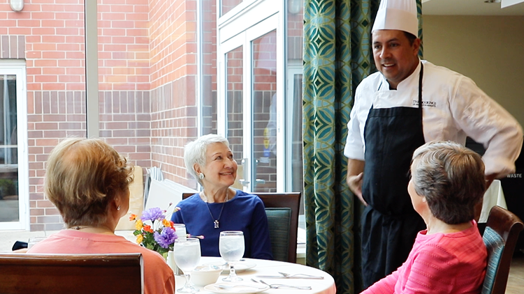 Women dining talking to the Chef at The Moorings