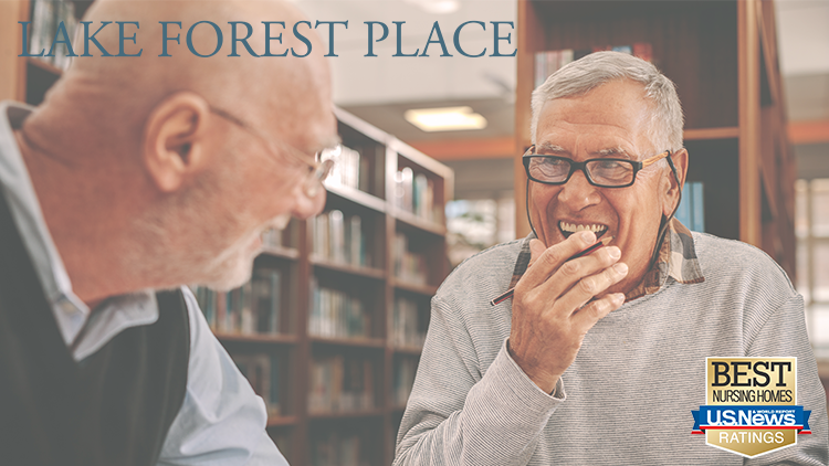 Two residents at Lake Forest Place enjoy their time spent together in the library.
