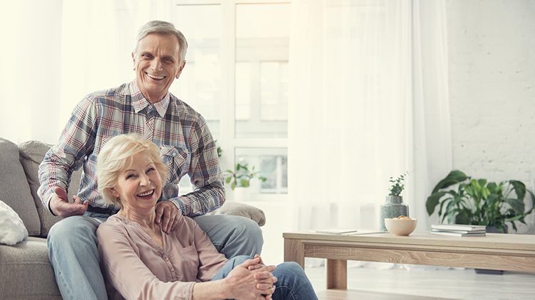 Senior couple happy about selling their home and moving in the Presbyterian Homes.