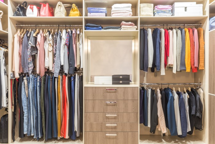 Organized closet with tiered shelving